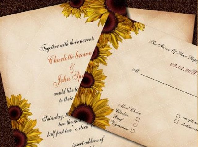 a traditional fall wedding invitation suite with sunflowers printed on the edges