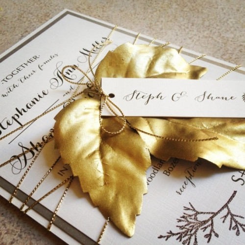 a glam fall wedding invitation suite in a monochromatic color scheme, glitter twine and a gold fall leaf on top