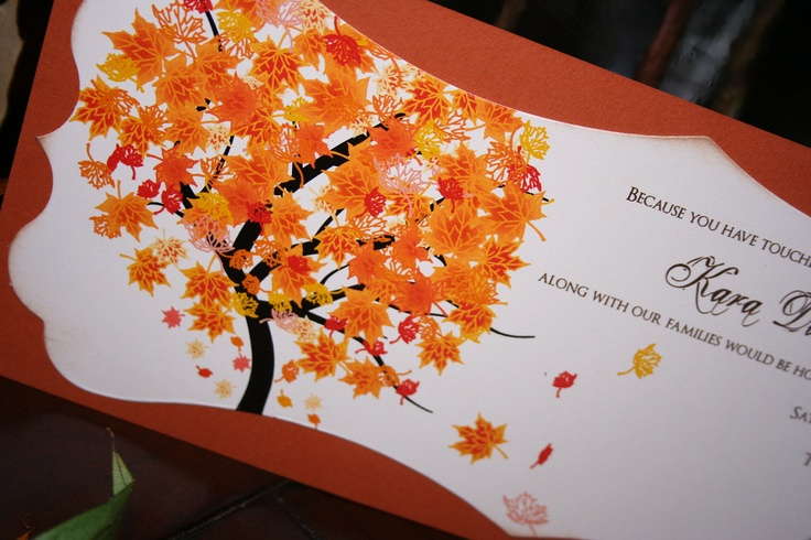 a bold fall wedding invitation with a fall tree and bright fall leaves printed for a bright and unique look