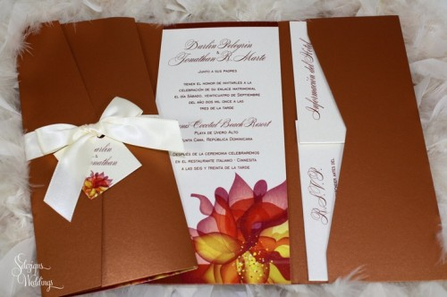 a bold fall wedding invitation suite on chocolate brown with bright fall blooms printed and a creamy bow