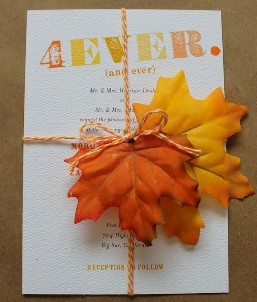 a fall wedding invitation suite with twine, colorful letters and bold fall leaves