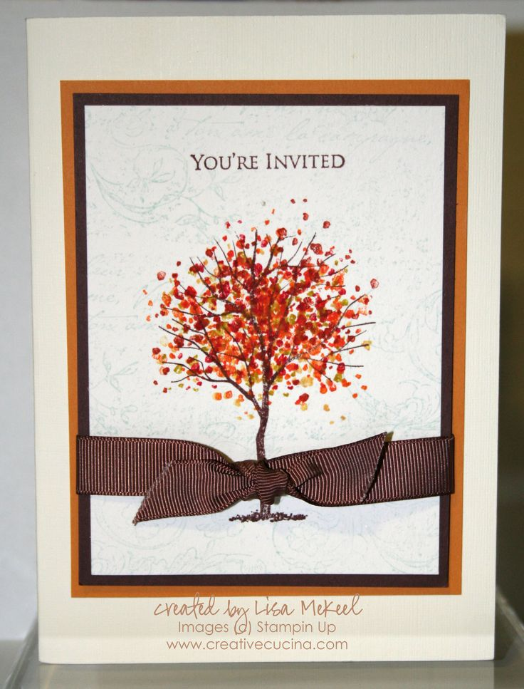 a stylish wedding invitation suite with a bright printed fall tree and a brown ribbon bow