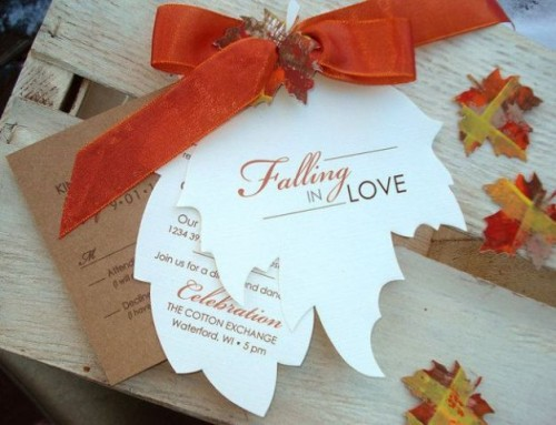 fall wedding invitations shaped as leaves and with an orange bow on top