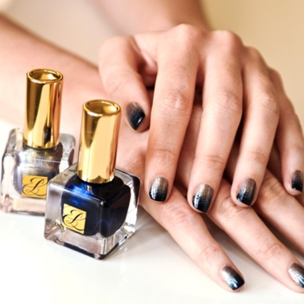 navy and gold glitter gradient nails are a bold and cool idea for a boho or some other manicure
