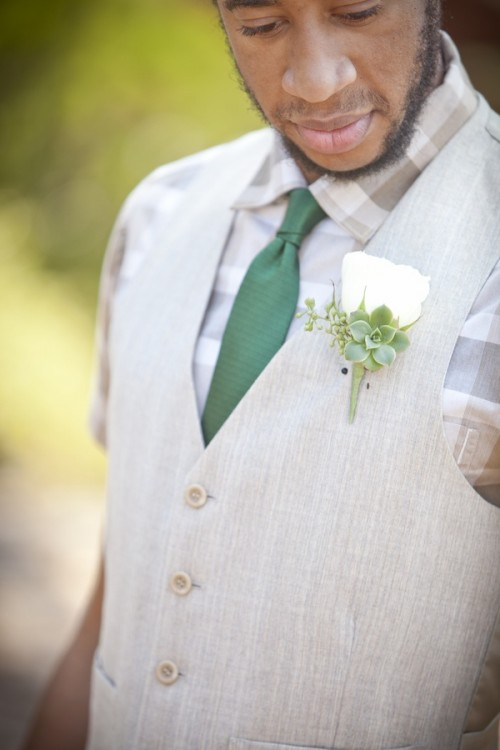 a non-jacket look with a neutral plaid shirt, a creamy waistcoat and an emerald tie to avoid overheating