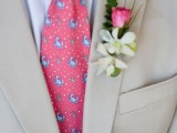 accent your tan suit with a bright printed tie and a boutonniere for a chic look