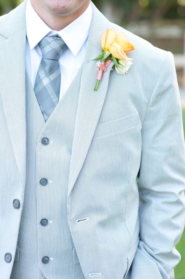 a refershing outfit with a light blue three piece suit, a printed tie and a white shirt