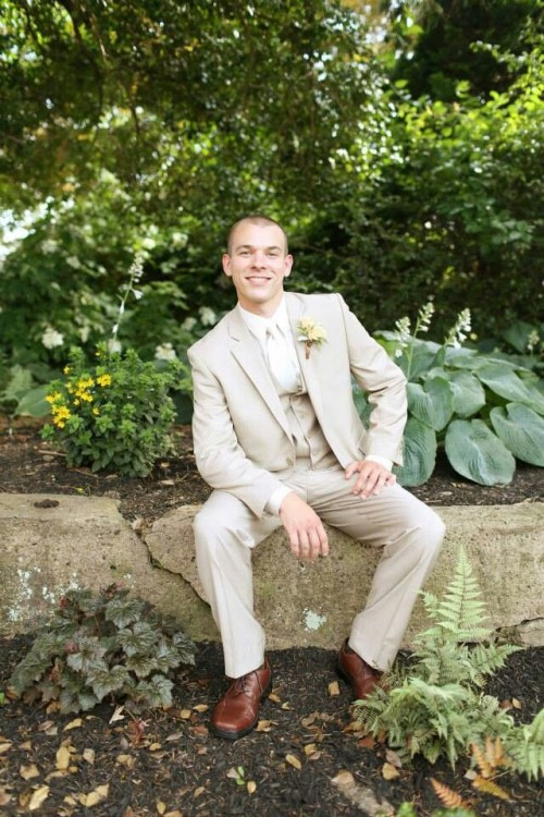 a tan three-piece groom's suit with a white shirt and a bow tie is suitable for a more formal wedding but choose lighter fabrics