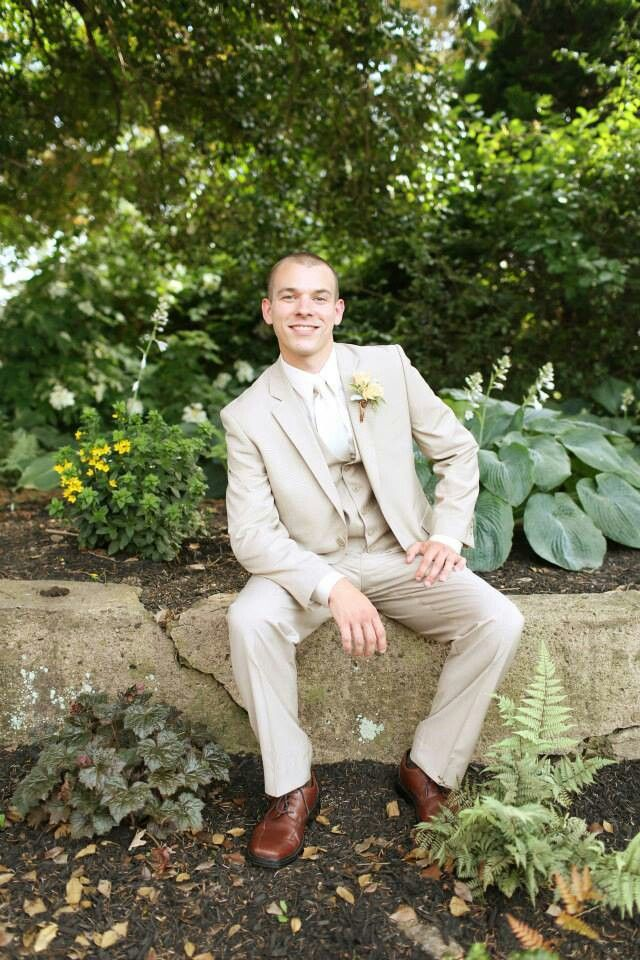 a tan three piece groom's suit with a white shirt and a bow tie is suitable for a more formal wedding but choose lighter fabrics