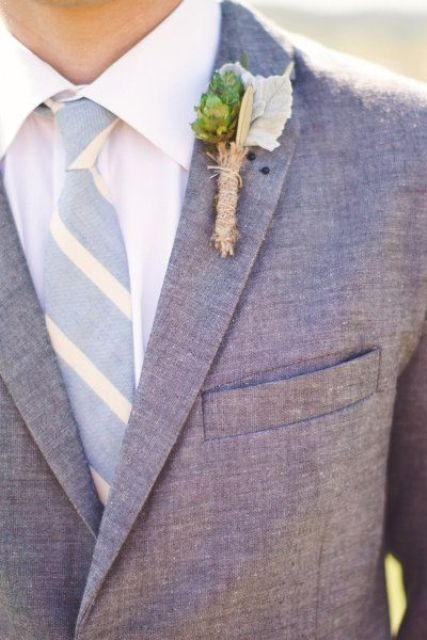 a simple look with a grey suit, a striped tie and a greenery boutonnniere