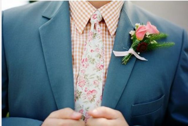 go whimsy with a grey suit, a tan plaid shirt, a floral tie and a matching floral boutonniere