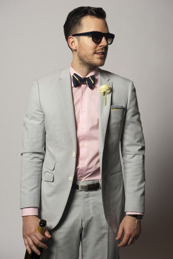 a light grey suit, a light pink shirt, a striped bow tie is a timeless combo for summer
