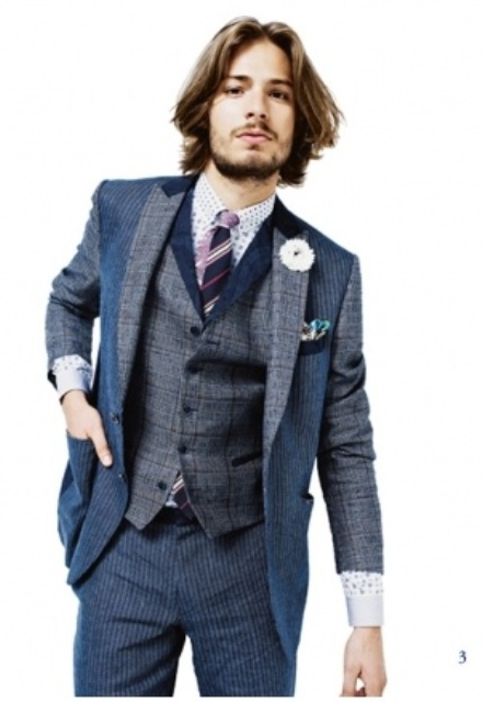 a dapper look for not a hot day, a grey and blue three-piece suit, a polka dot shirt and a striped tie