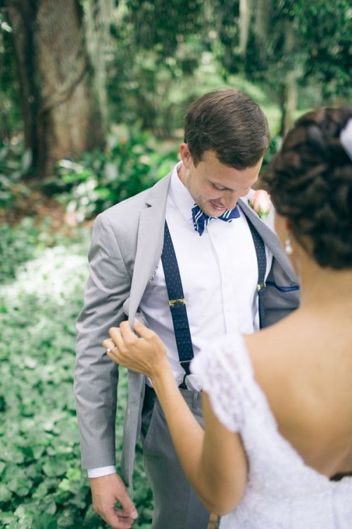 a stylish groom's look with a retro feel added with suspenders and a printed bow tie
