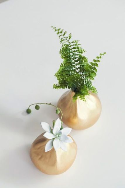 a minimalist wedding centerpiece of gilded vases with succulents and ferns is a stylish idea