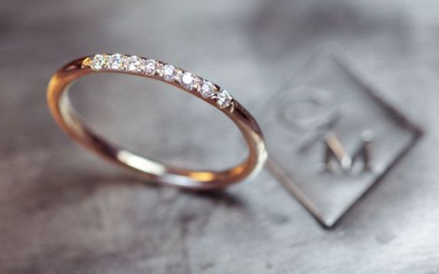 a minimalist gold wedding band with diamonds is a chic and stylish accessory for the wedding