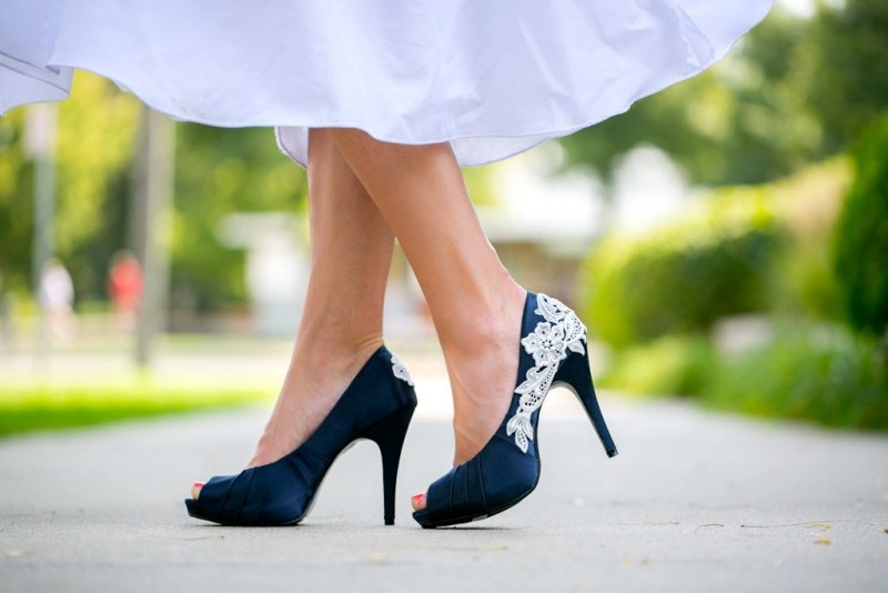navy peep toe shoes with white lace for a bride or bridesmaids are a cool touch of color