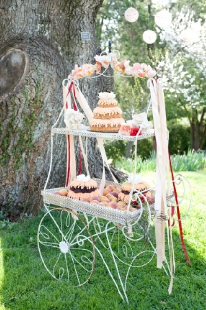 a whimsical dessert table styled as a wire cart, bright blooms and long ribbons and delicious sweets and desserts