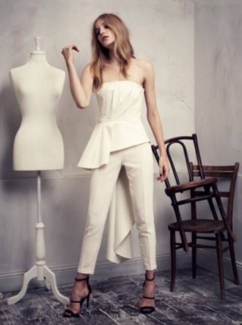 white cropped fitting pants and a matching strapless top with a draped bodice and a train for a statement look