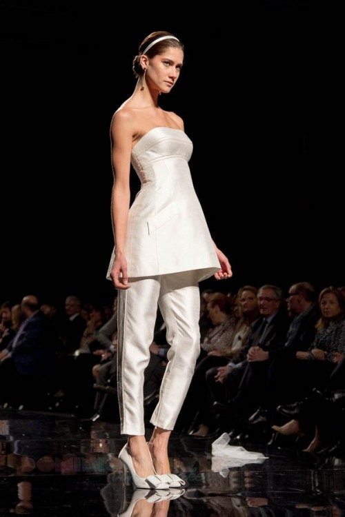 a vintage-inspired bridal pantsuit with a strapless long top and fitting pants plus white shoes with bows