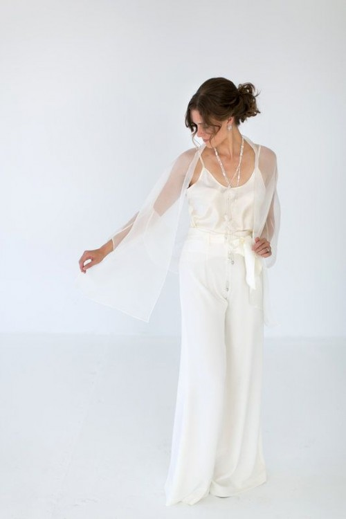 a white top, white palazzo pants, a sheer coverup, layered necklaces for a casual and chic bridal look