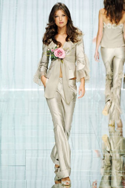 a silver bridal pantsuit with a blazer with bell sleeves and low pants plus silver shoes