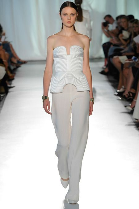 an haute couture bridal look with white palazzo pants, a strapless sculptural top with patterns and white shoes
