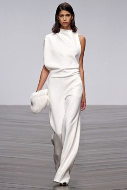 a minimalist bridal pantsuit with palazzo pants and an oversized one shoulder top for an ultra minimal look