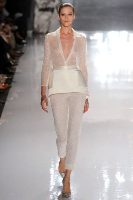 an all-glam bridal pantsuit with glitter pants and a top plus a mini skirt with pockets for an haute couture bride