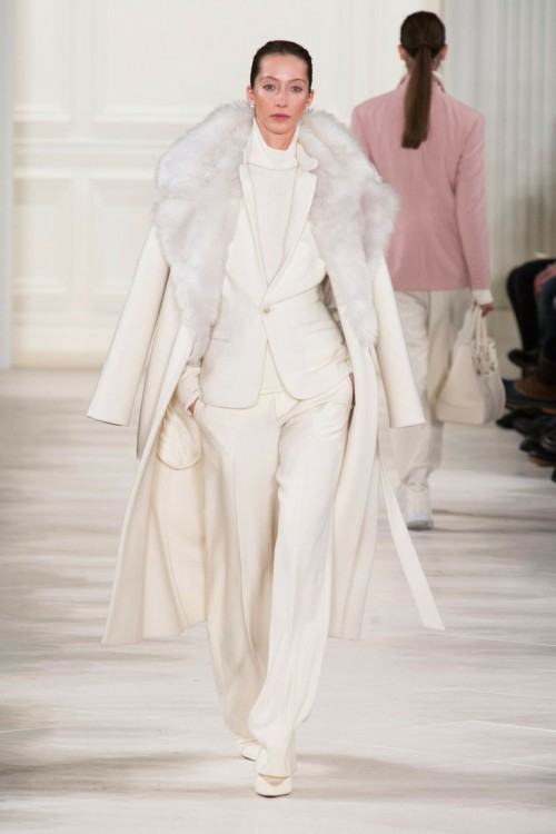 a creamy pantsuit plus a matching turtleneck and a creamy coat with faux fur for a winter casual bride