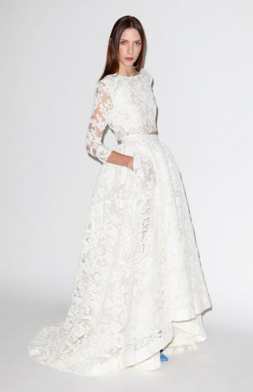 a chic and beautiful lace bridal separate with a crop top with a high neckline, long sleeves and a high low skirt with a train plus blue shoes