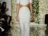a whimsical modern bridal separate with an embellshed crop top, short sleeves and a high neckline and a fitting skirt with a train