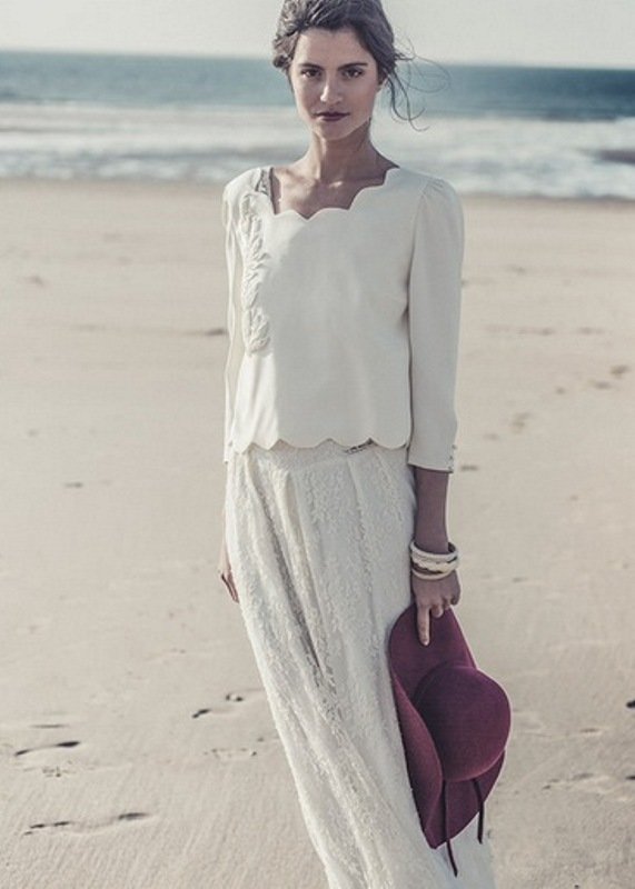a casual yet chic bridal separate with a plain top with embroidery and a scallop edge, a lace maxi skirt and a burgundy hat is a lovely outfit for a casual beach wedding
