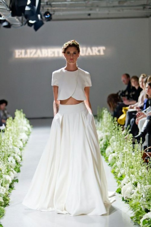 an ultra-modern bridal separate with a crop top that features a creative edge, short sleeves and a high neckline and a full skirt with pockets