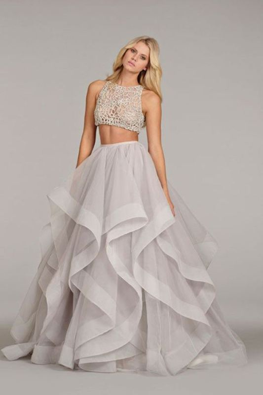 a glam bridal separate with a textural and applique crop top and a full layered skirt with a catchy edge is gorgeous