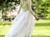 a neutral long-sleeve top and a lace maxi skirt plus blue shoes for a stylish and casual bridal look