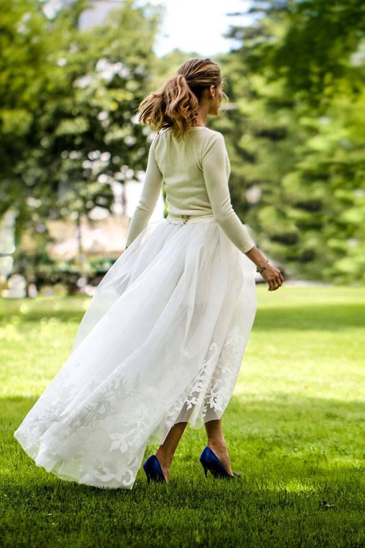 a neutral long sleeve top and a lace maxi skirt plus blue shoes for a stylish and casual bridal look