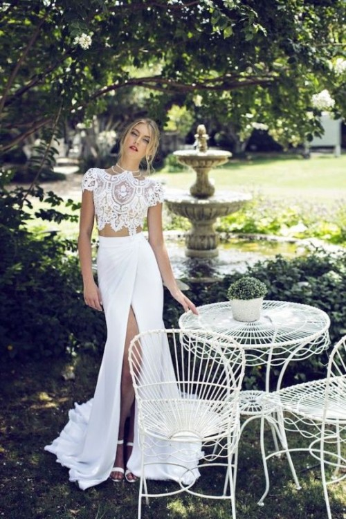 a very eye-catchy bridal separate with a lace cap sleeve crop top and a high neckline plus a maxi wrap skirt and a train is amazing and chic
