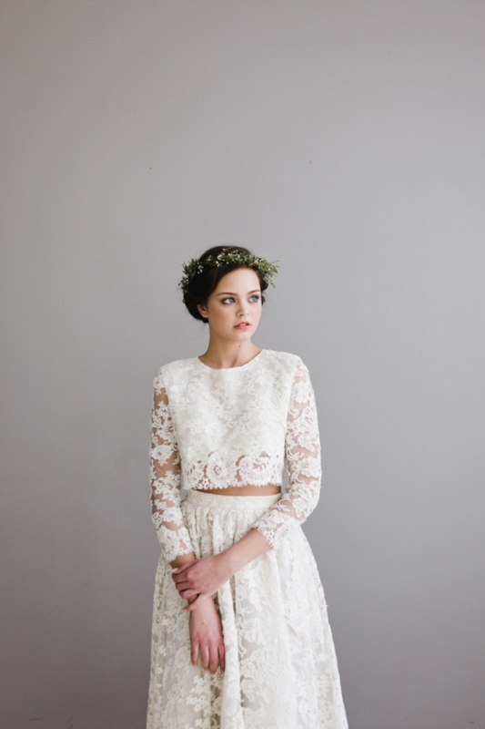 a romantic lace bridal separate with a crop top with a high neckline and long sleeves and a long A line skirt for a boho bride