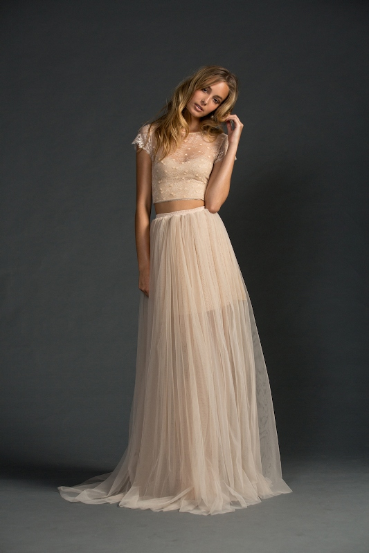 a romantic and lovely blush bridal separate with a crop top with an illusion neckline and short sleeves and a maxi skirt with a short underskirt is beautiful