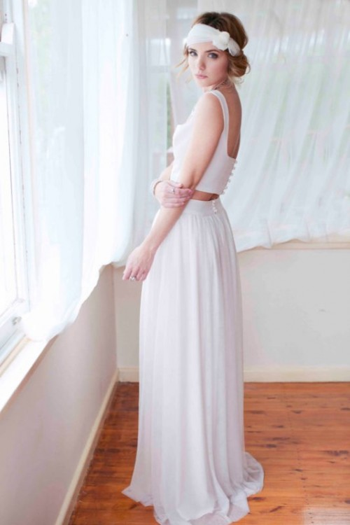 a vintage-inspired bridal separate with a crop top, a deep neckline and a cutout back plus a pleated maxi skirt