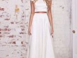 a minimalist bridal separate with a plain crop top with short sleeves and a pleated A-line maxi skirt is very elegant
