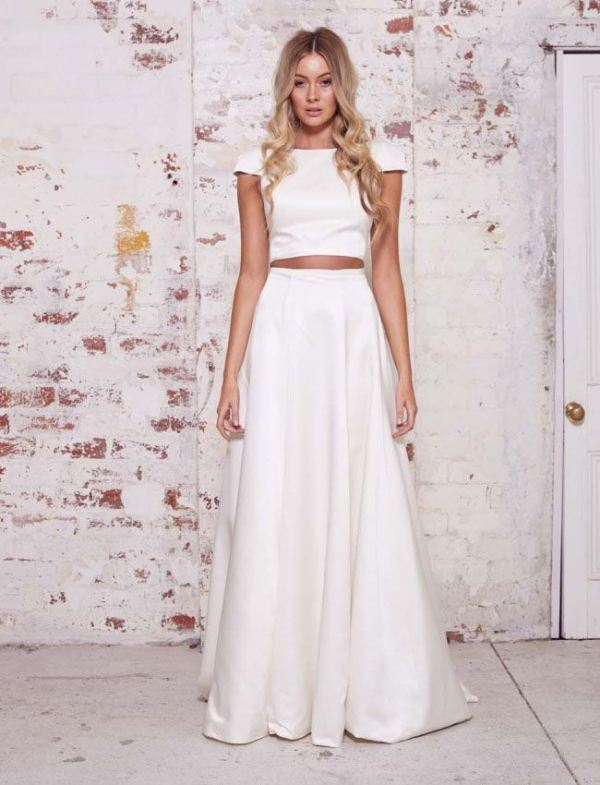 a minimalist bridal separate with a plain crop top with short sleeves and a pleated A line maxi skirt is very elegant