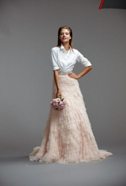 a modern bridal separate with a white shirt and a blush ruffle A-line maxi skirt is a very modern and bold idea