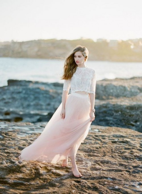 a white lace crop top with a high neckline and short sleeves, a pink flowy maxi skirt for a romantic and airy bridal look