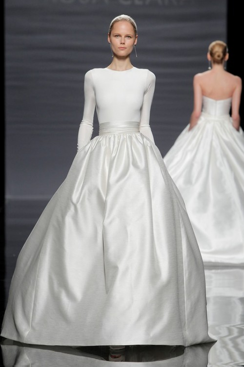 a white fitting long sleeve top with a high neckline and a shiny full skirt with a sash for a more formal look at the wedding