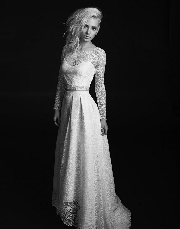 a sexy lace bridal separate with a crop top and long sleeves plus an illusion neckline and an A line high low skirt with a train