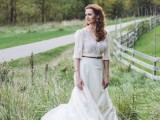 a lovely vintage-inspired bridal look with a lace top with a deep neckline and long sleeves and a plain skirt decured with a thin belt is gorgeous