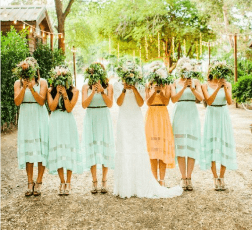 matching mint dresses for everyone and a marigold one for the maid of honor to brighten up your summer color palette