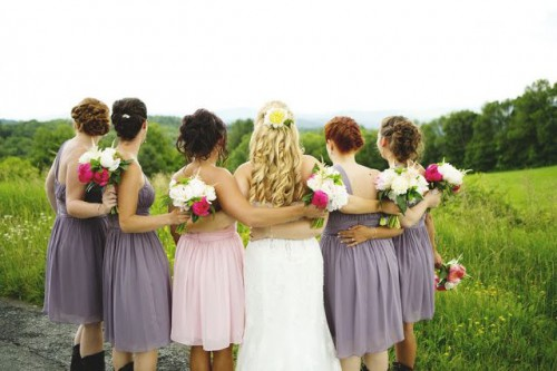 mismatching short grey bridesmaid dresses and a light pink one for the maid of honor